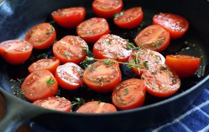 tomatoes cooking in cast-iron